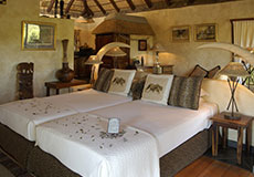 The bed in a Safari Suite