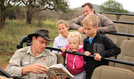Children on a game drive at Thanda